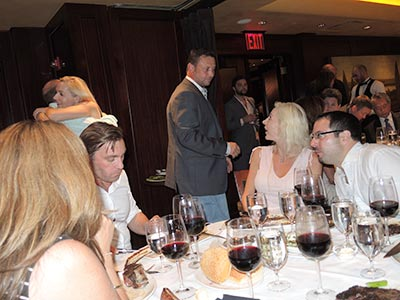 Doctors mingling and conversing at Del Frisco's Steakhouse